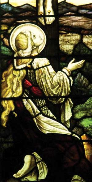 Magdalene at the crucifixion... A church window in Dorset Village, UK